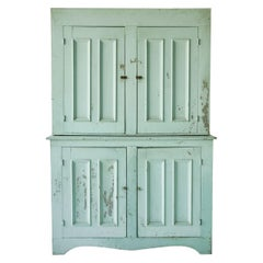 Early American Four Door Step Back Cupboard