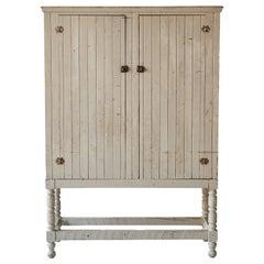 Early American Tan Painted Two Door Cupboard on Legs