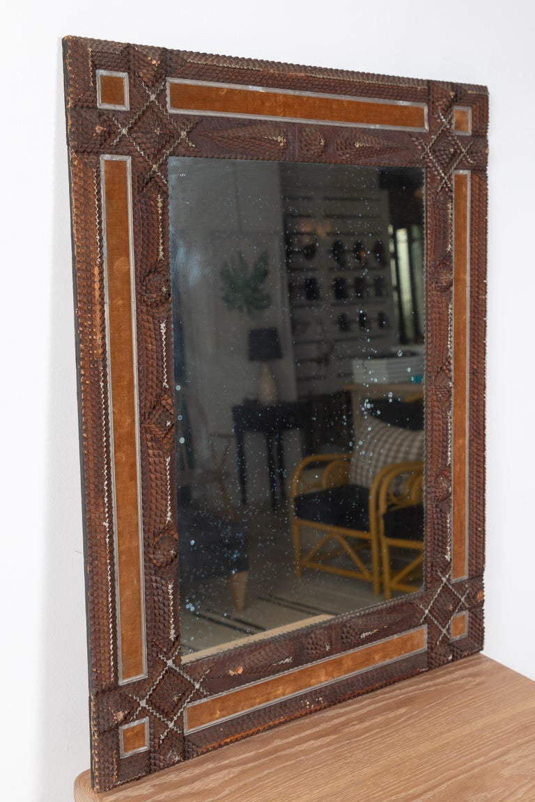 Early American Tramp mirror with unique Tramp style details. The glass is original.
