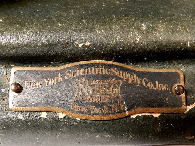 This is one of the earliest examples of hard rubber casting. I'm guessing 1915 to 1920. It's hand painted and very heavy for its size. There is a domed brass plaque that reads New York Scientific Supply Co. Inc.
