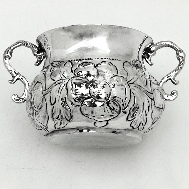 A wonderful 17th century Charles II Antique solid Silver Porringer / two handled Cup with an ornate chased floral design around the bellied body of the Cup. The Cup has two elegant scroll handles.  Made in 1675 by maker TA (Makers Mark in Jackson's