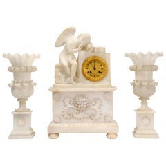 Early Antique French Alabaster Clock Set, Cupid L'Amour Menaçant after Falconet