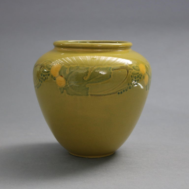 An antique and early Arts & Crafts vase by Roseville offers art pottery construction with floral and foliate band in a rare experimental glaze, signed and numbered on base as photographed, 1920-1930  Measures: 6.25