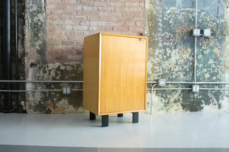 Early and uncommon example of the BCS (Basic Cabinet Series) by George Nelson and Associates for Herman Miller. Features two adjustable shelves inside. A nice rich patina with slight sun fading to one side. Very good condition. Marked inside with