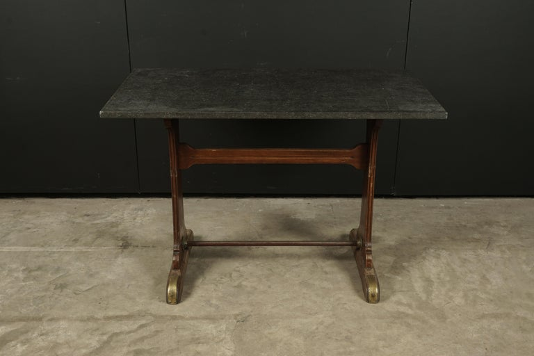 Vintage bistro table from France, 1950s. Original base with later top of Belgian blue stone.