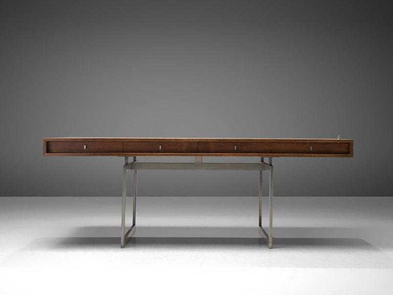 Bodil Kjaer for E. Pedersen & Søn, table model 901, wenge and chrome steel, Denmark, 1959.  This freestanding desk in wenge is designed by the Danish designer Bodil Kjaer. The desk can be used with multiple purposes, as a writing table, desk or
