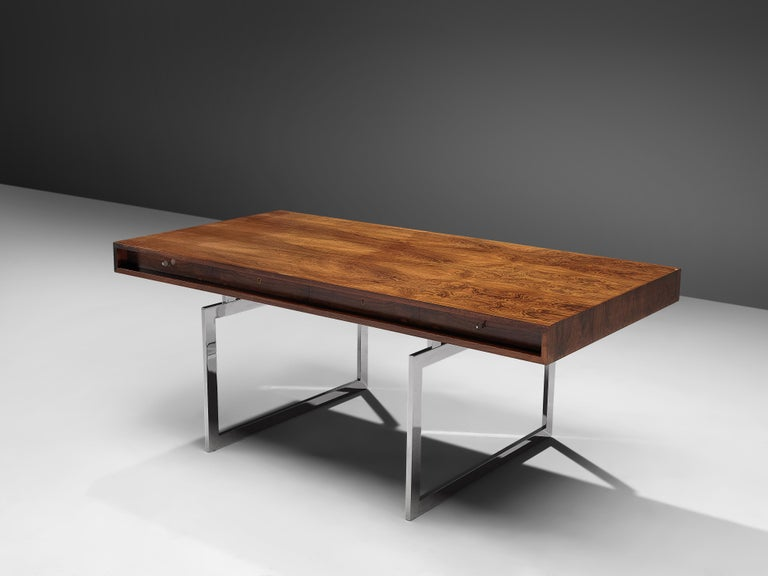 Bodil Kjaer for E. Pedersen & Søn, table model 901, Brasilian hardwood and chrome steel, Denmark, 1959.  This free-standing desk in rosewood is designed by the Danish designer Bodil Kjaer. The desk can be used with multiple purposes, as a writing
