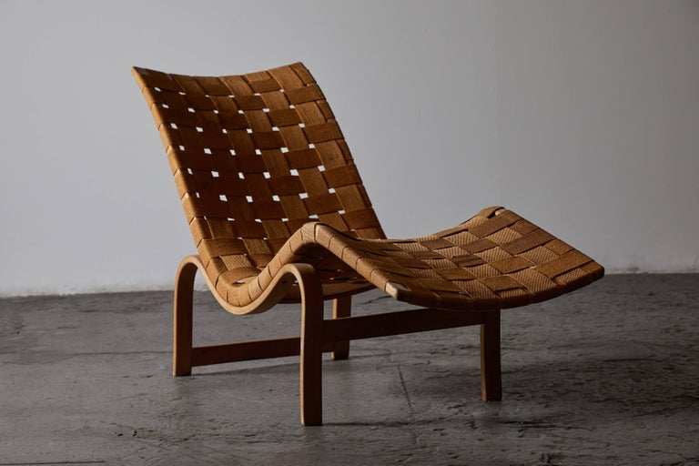 Early chaise lounge with original canvas webbing by Bruno Mathsson for Firma Karl Mathsson. Made in Sweden circa 1936. Retains all original labels with dates.
