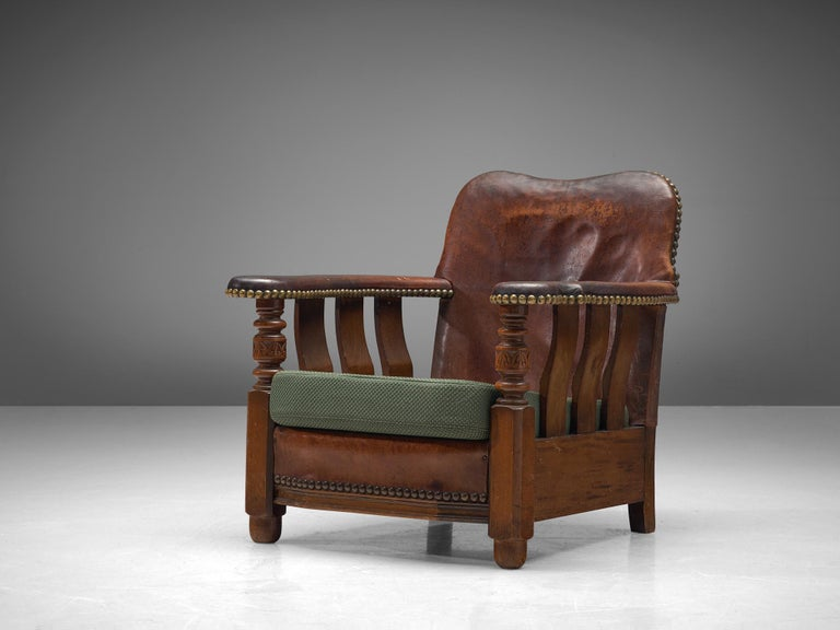 Armchair, wood, leather and fabric, Denmark, 1920s.