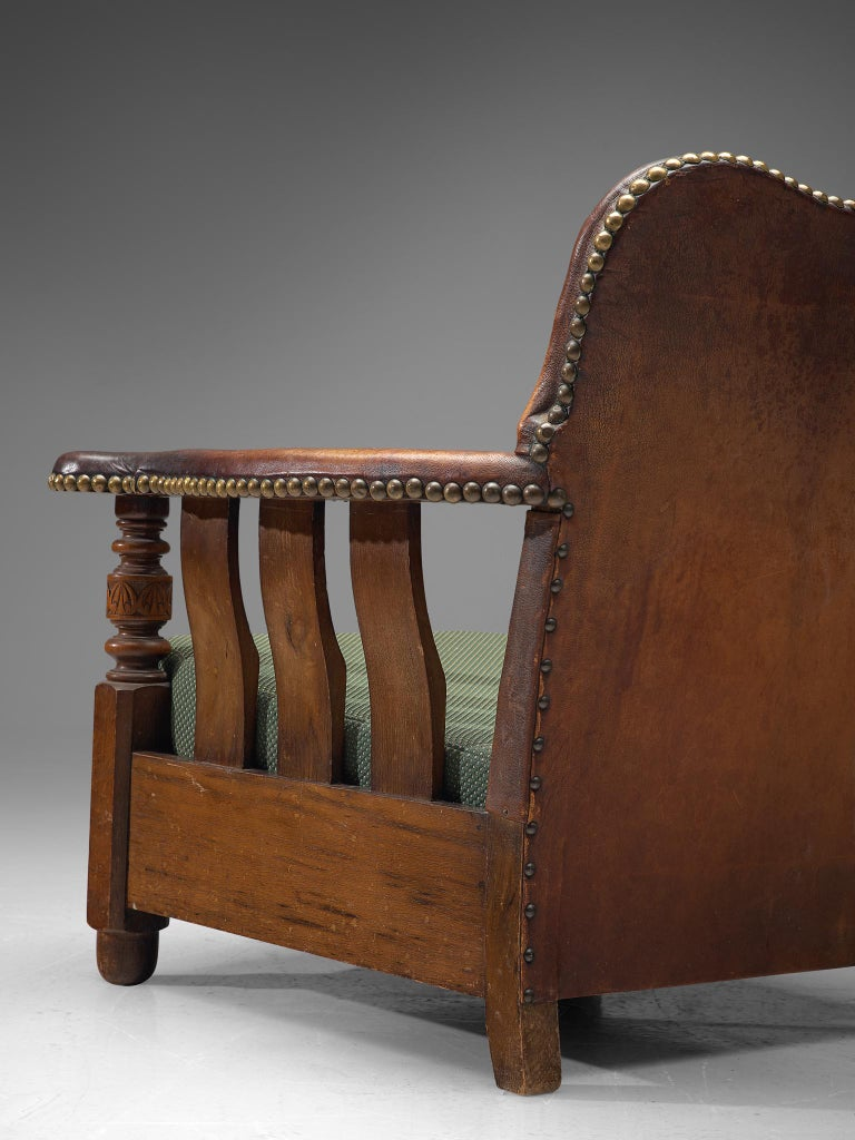 Early 20th Century Early Danish Armchair with Patinated Leather For Sale