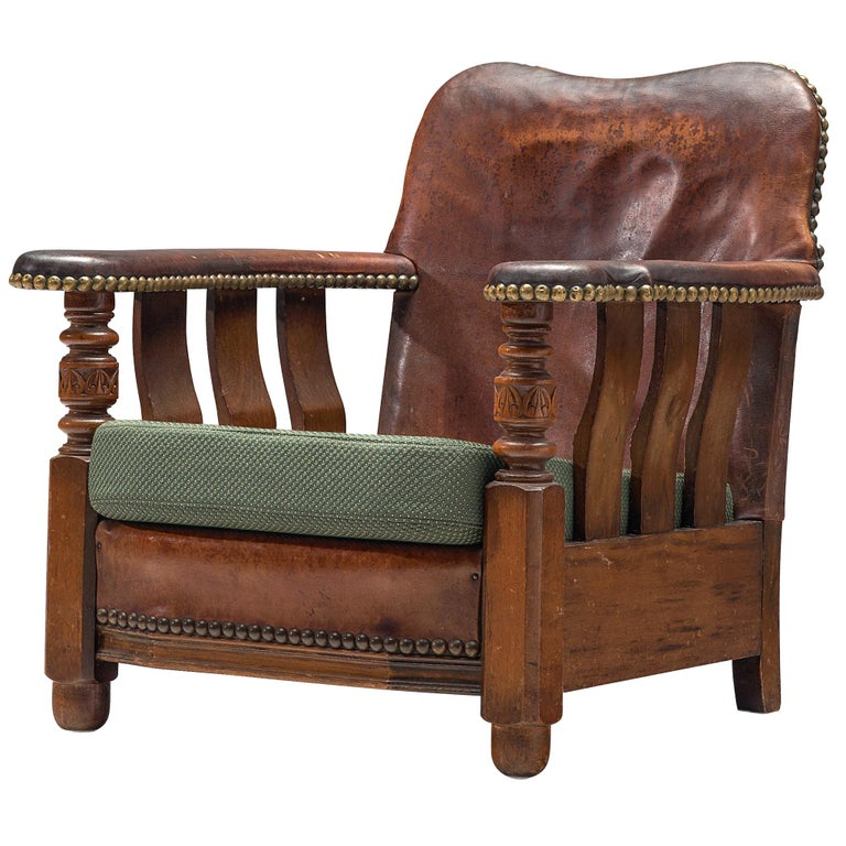 Early Danish Armchair with Patinated Leather For Sale