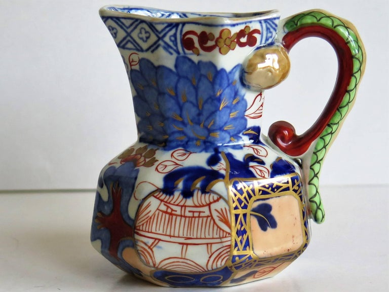 This is a good small Hydra jug, pitcher or cream jug made by the Davenport Company of Longport, Staffordshire, England in the late Georgian period, circa 1805-1820, made of Ironstone pottery, which Davenport called Stone China.