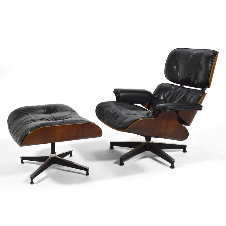 An exceptional early example of the iconic design by Charles and Ray Eames with great provenance, this 670 lounge chair and matching 671 ottoman is entirely original. It features down-filled cushions, rosewood shells, rubber spacers, and has a