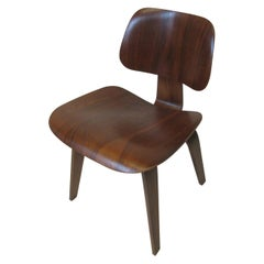 Early Eames Sculptural Walnut DCW by Herman Miller  ( A )