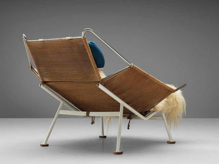 Hans Wegner, Flag Halyard chair GE225, rope, white lacquered steel, Denmark, 1950.  This iconic chair, made with 250 meter of rope, is designed by Hans Wegner. The name Flag Halyard simply comes from the innovative material with which Wegner makes
