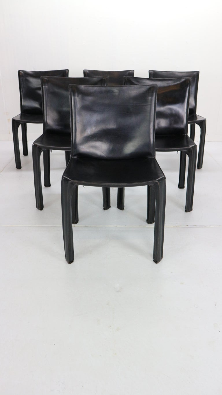 Set of 6 dining room chairs designed by Mario Bellini and manufactured by high quality design furniture fabric- Cassina in 1970s period, Italy. This chairs are the early edition of the manufacture. Model- Cab 412. All chairs are marked and in a