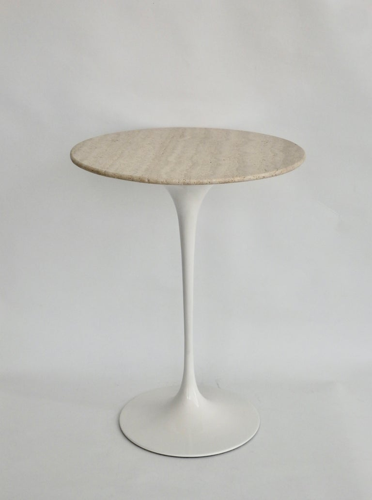 Eero Saarinen for Knoll Tulip table. Early one-piece cast iron base evens center of gravity keeping the table well balanced. Top is open grained travertine.