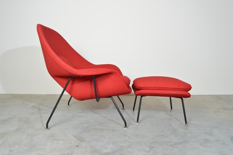 Eero Saarinen for Knoll Womb chair and ottoman produced in 1969 as documented on its frame having Knoll tweed upholstery.   In stunning condition. Fresh foam and new old stock Knoll upholstery applied by a Knoll specialist.  Ottoman Dimensions:
