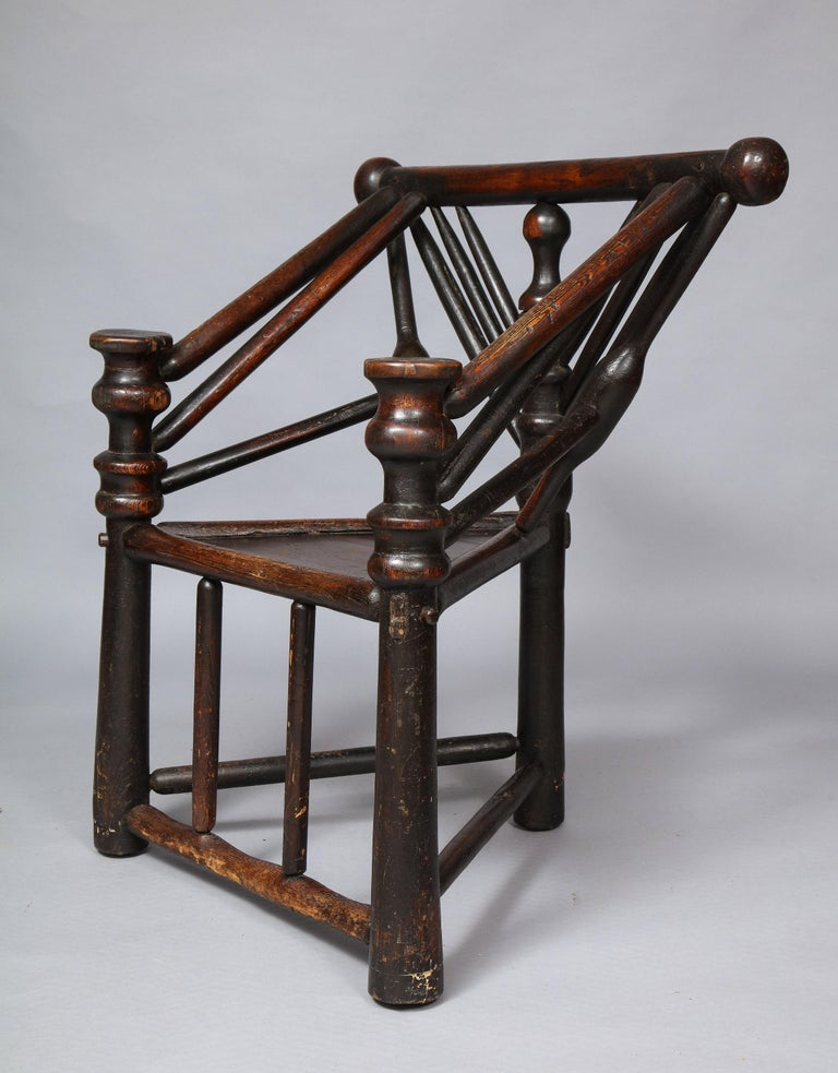 Rare Elizabethan or Jacobean turned fruitwood and ash three legged chair, often referred to as a