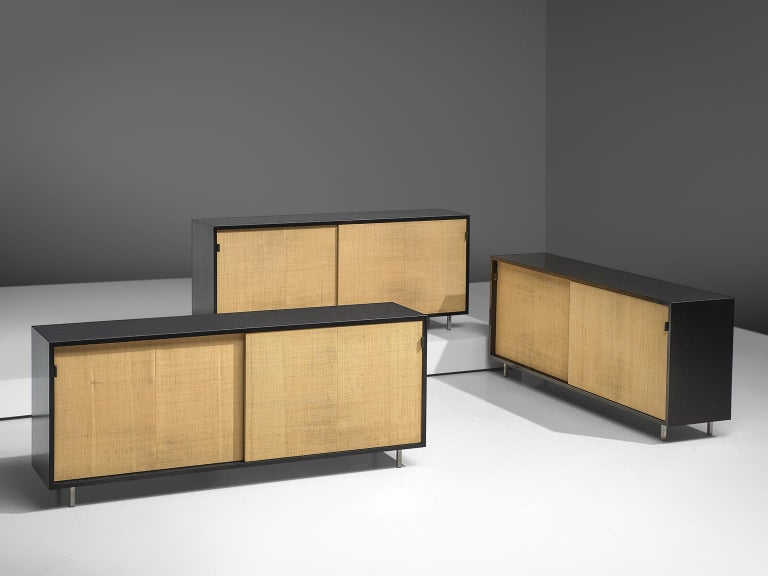 Florence Knoll for Knoll, sideboards, ebonized wood, metal, cane, United States, 1961.  These sideboards are designed by Florence Knoll for Knoll International and were meant for the headquarters of Knoll in Italy. The credenzas are executed with