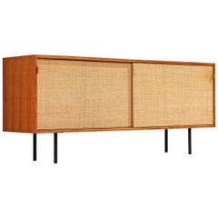 Early Florence Knoll Walnut Credenza with Cane Sliding Door