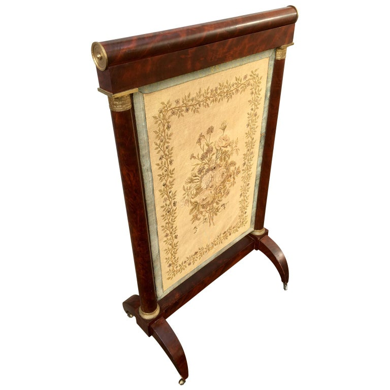 Early French 19th century Empire mahogany and gilt bronze firescreen Screen has a period embroidered flower decorated insert.