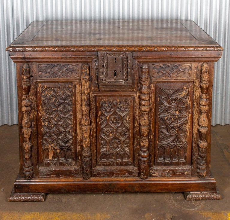 Discovered during our recent European travels, we just adored the extraordinary carving of this 18th century Gothic trunk in French oak with a large scale intricately detailed iron lock. The top lifts open revealing large storage space inside and