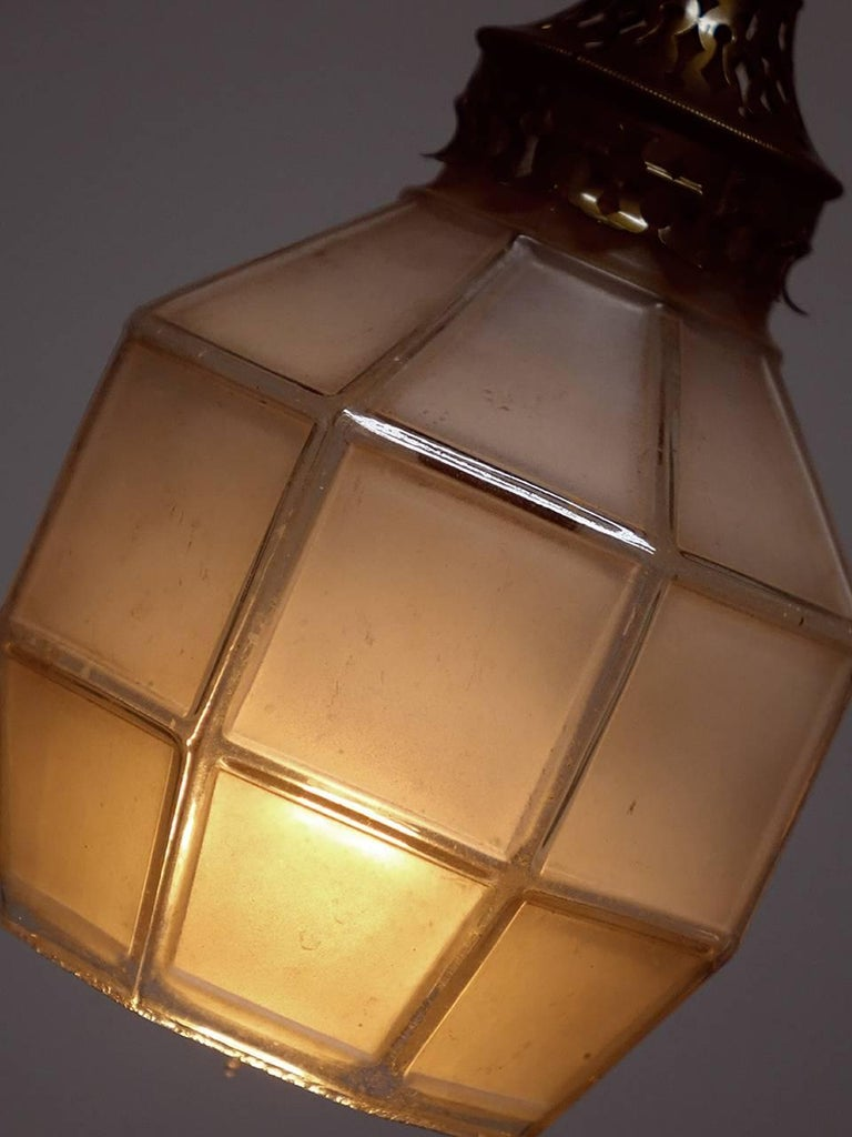These delicate and early Arts & Crafts style shades were originally used for gas lamps. We rewired each using the original brass fittings to take a candelabra bulb. The glass is cast in one piece but looks like leaded glass panels. We have priced