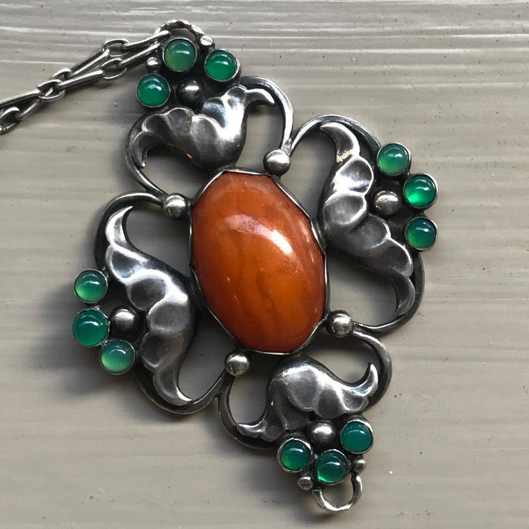 Early Georg Jensen 830 Silver Large Pendant  No. 40 with Amber and Chrysoprase  With original chain, 16.5''  long, very good condition considering its age.  Designer: Georg Jensen Maker: Georg Jensen Design #: No.40 Circa: 1915-1919 Dimensions: