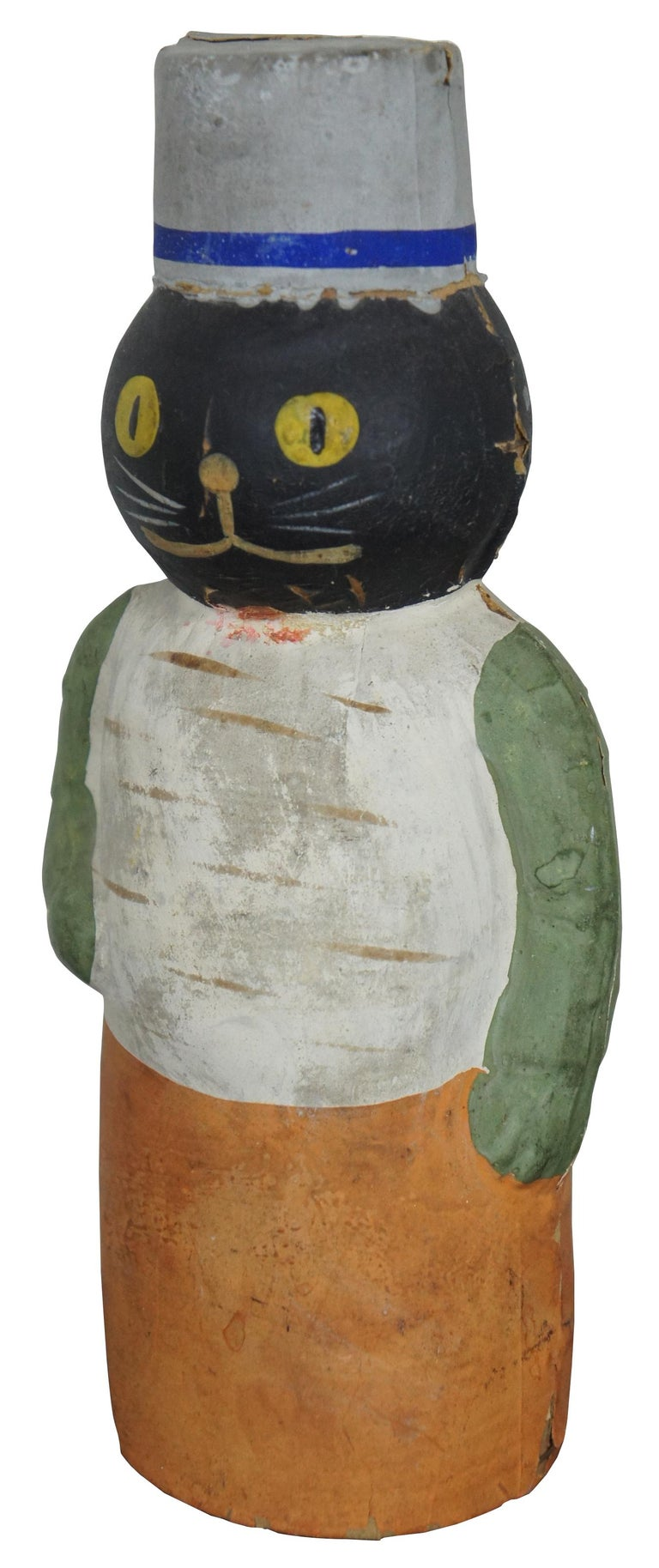 """Antique German papier mâché anthropomorphic candy container, shaped like a black cat with yellow eyes dressed in orange, green and white with a gray pill box hat, displayed in a wood base bell jar.  Measures: Bell jar 6.25"""" x 10.75"""" / cat 3.5"""" x"""