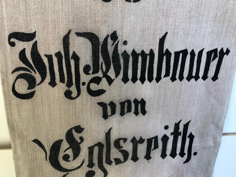 Early German handwoven hemp and linen grain sack with original calligraphy and graphics. It was made from hemp and linen by the farmer's wife and used to store grains in the barn. The farmer's name, town and inventory # were stamped on the bag with