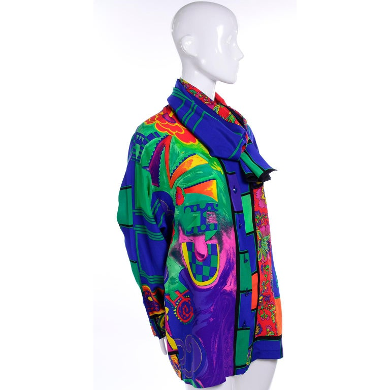 This is an absolutely gorgeous vintage Gianni Versace blouse in a beautiful mixed pattern silk print and a coordinating scarf. The blouse is from the late 1980's or early 1990's and was designed by Gianni Versace himself. Vibrant shades of blue,
