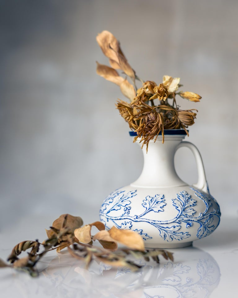 A rare, small blue and white Parian porcelain vase made by G. Grainger & Co. circa 1839.  This petite vase, a rare style made by G. Grainger & Co. Worcester circa 1839, features a design of oak leaves carved in relief on an unglazed porcelain