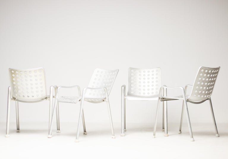 Four Landi aluminium stacking chairs, designed by Hans Coray for the Swiss National Exhibition in Zurich in 1938, executed in the 1950s by P. & W. Blattmann Metallwarenfabrik Wädenswil (MEWA), Switzerland. These examples have 91 holes in total