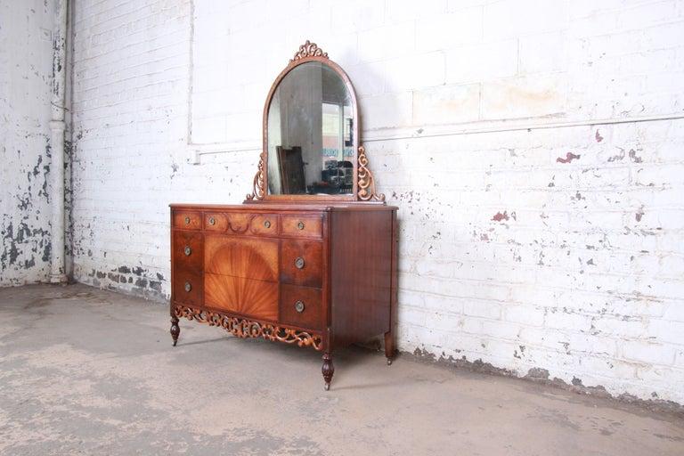 Antique five-drawer walnut dresser with mirror  Early Herman Miller