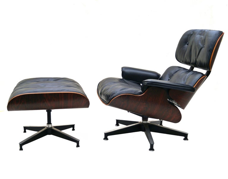 Early Herman Miller rosewood Charles & Ray Eames black leather lounge chair and ottoman. Grey Duck feathers/ down. Also has Latex. Latex label is loose. All wood pieces are marked 953 with a 3 below. Has older clips and black circle Herman Miller