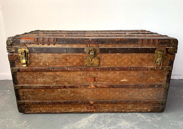 A large vintage Louis Vuitton steamer trunk. Early production from turn of the century (after 1896 with the presence of the LV logo, and likely before 1910). From the descendants of James J. and Mary T. Hills. James Jerome Hill (1838-1916), was a