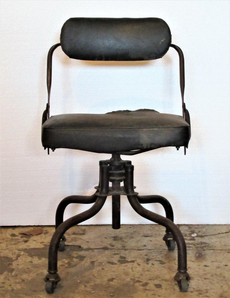 Antique American industrial rolling swivel desk task chairs by Domore Chair Company in original vintage condition. Taller chair measures 31 inches high x 20 inches to seat / lower chair measures 29 inches high x 18 inches to seat (dark green oil