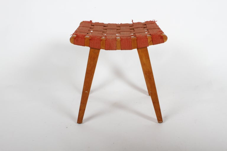 Early Jens Risom for Knoll strap stool for Knoll, missing label, but date stamped May 15, 1952. Original finish shows age, original strap webbing worn, should be replaced. Small split to one end, see photos.