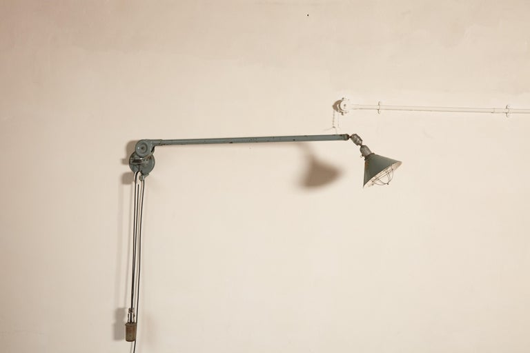 A rare early Johan Petter Johansson Industrial triplex telescopic lamp, with counterweight, Sweden, circa 1910s. Can be wall, floor or ceiling hung. Extends up to 300cm. Adjustable in many directions. Nice original condition - with some marks, paint