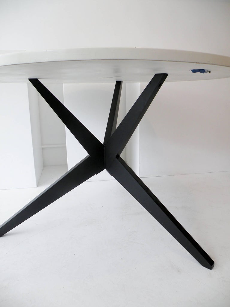 Early painted wood with laminate top, Popsicle dining table. Knoll production.