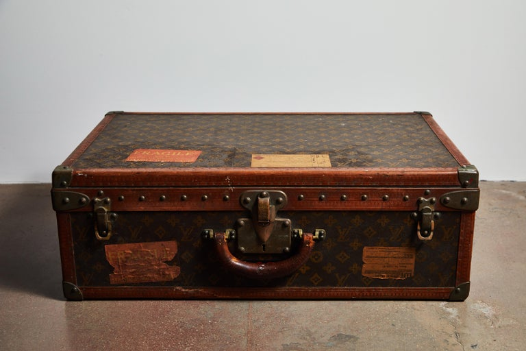 Early patinated Louis Vuitton hard case luggage or trunk. Has original travel stamps and initials of owner. Made in France, circa 1940s.