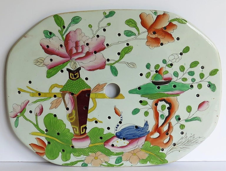 This is a large beautifully hand-painted Mason's ironstone drainer plate, in the table and flower pot pattern, from their earliest George IIIrd period, circa 1815.  Mason's Ironstone drainers and strainers tend to be fairly rare.  This piece is in