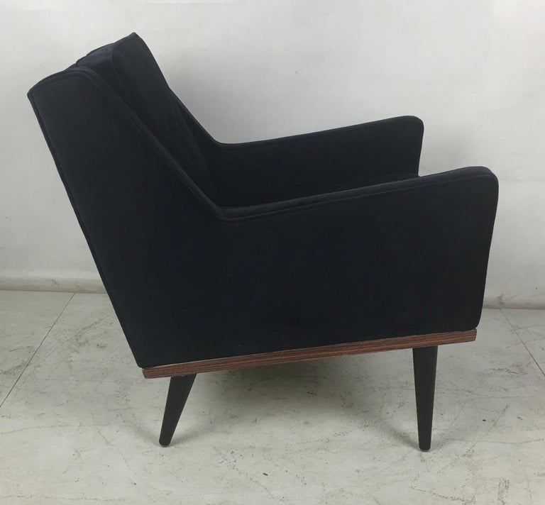 Handsome lounge chair by Milo Baughman for James, Inc. The chair has been completely restored from the ground up including new veneer on the apron, refinished legs, and has been reupholstered in luxurious heavyweight navy blue velvet. The chair is
