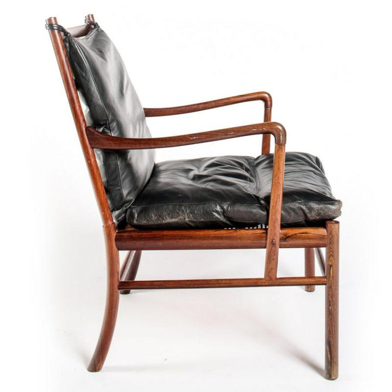 One of Ole Wanscher's most iconic and revered designs. Model PJ-149 was inspired by British and French Colonial furniture of the 18th and 19th centuries. Highly figured Brazillian rosewood, which is the most desirable timber option for this design.