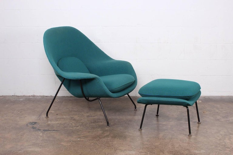 An early, all original Womb chair and ottoman designed by Eero Saarinen for Knoll.