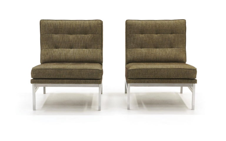 Early and rare pair of Florence Knoll chairs. Expertly reupholstered. These predate the parallel bar series with a simpler, cleaner, square tube brushed steel frame. Place them side by side to form a loveseat / settee.