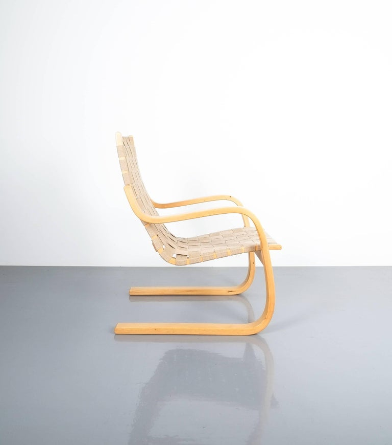 Early pair of Alvar Aalto chairs model 406 Artek, 1960. Nice pair of armchairs made from laminated birch. This is an early production by Artek, circa 1960. Still in very good condition. Priced and sold as a pair.