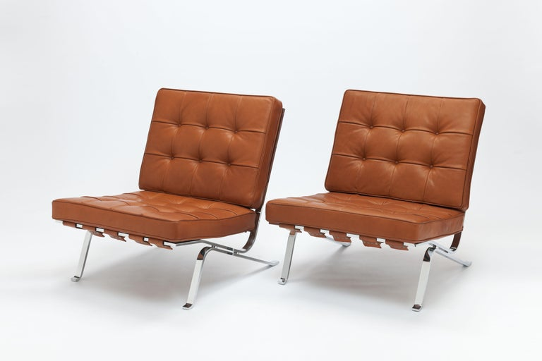 Early pair of lounge chairs model RH301 by renown Swiss architect Robert Haussmann from 1954. This design is also known as 'Hommage a Mies van der Rohe' because the chair was designed as a tribute to his idol Mies van der Rohe.   These chairs are