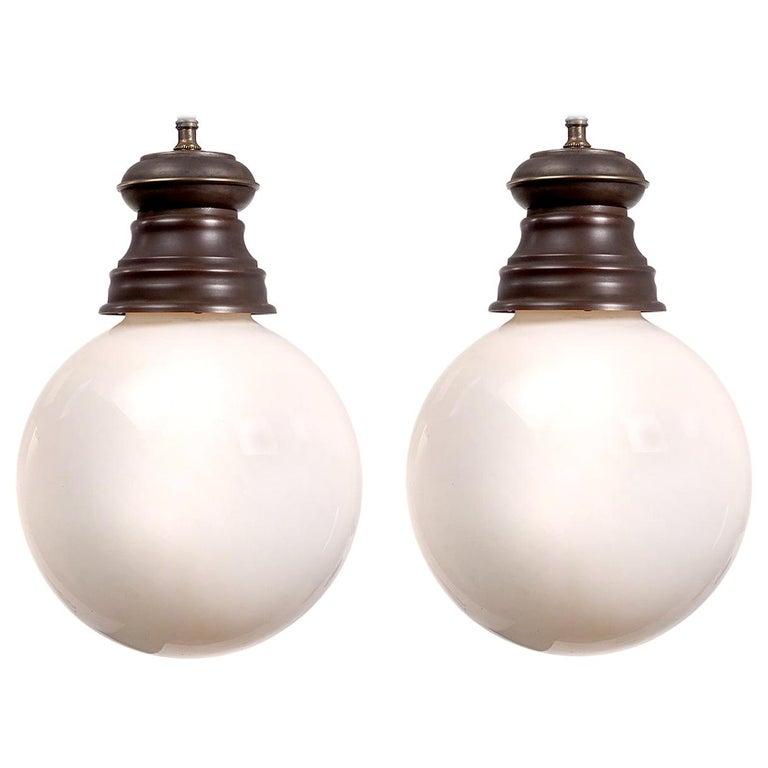 Early Pair of Hand Blown Milk Glass Globe Pendants For Sale